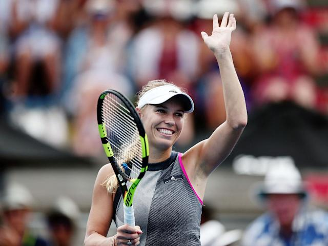 Caroline Wozniacki acknowledges the crowd after securing victory: Getty