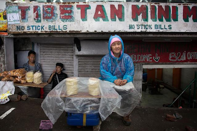 <p>Pema Kyi, a 40-year-old exile Tibetan, sells Tibetan bread by the roadside in Dharmsala, India, Tuesday, June 20, 2017. Pema, who lives alone, came into exile seven years ago and supports herself by baking and selling bread. (Photo: Ashwini Bhatia/AP) </p>