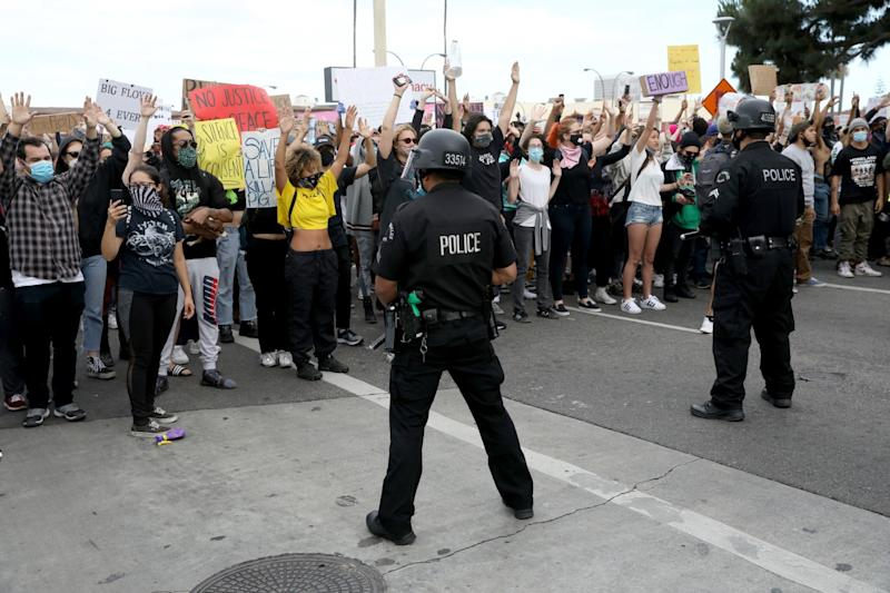 Police and protesters face off
