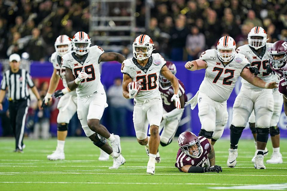 HOUSTON, TX - DECEMBER 27: Oklahoma State Cowboys running back Chuba Hubbard (30) runs the ball during the college football game between the Oklahoma State Cowboys and Texas A&M Aggies on December 27, 2019 at NRG Stadium in Houston, TX.  (Photo by Daniel Dunn/Icon Sportswire via Getty Images)