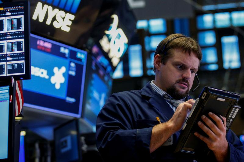 FILE PHOTO - A trader works on the floor of the New York Stock Exchange (NYSE) in New York, U.S., September 8, 2017. REUTERS/Brendan McDermid