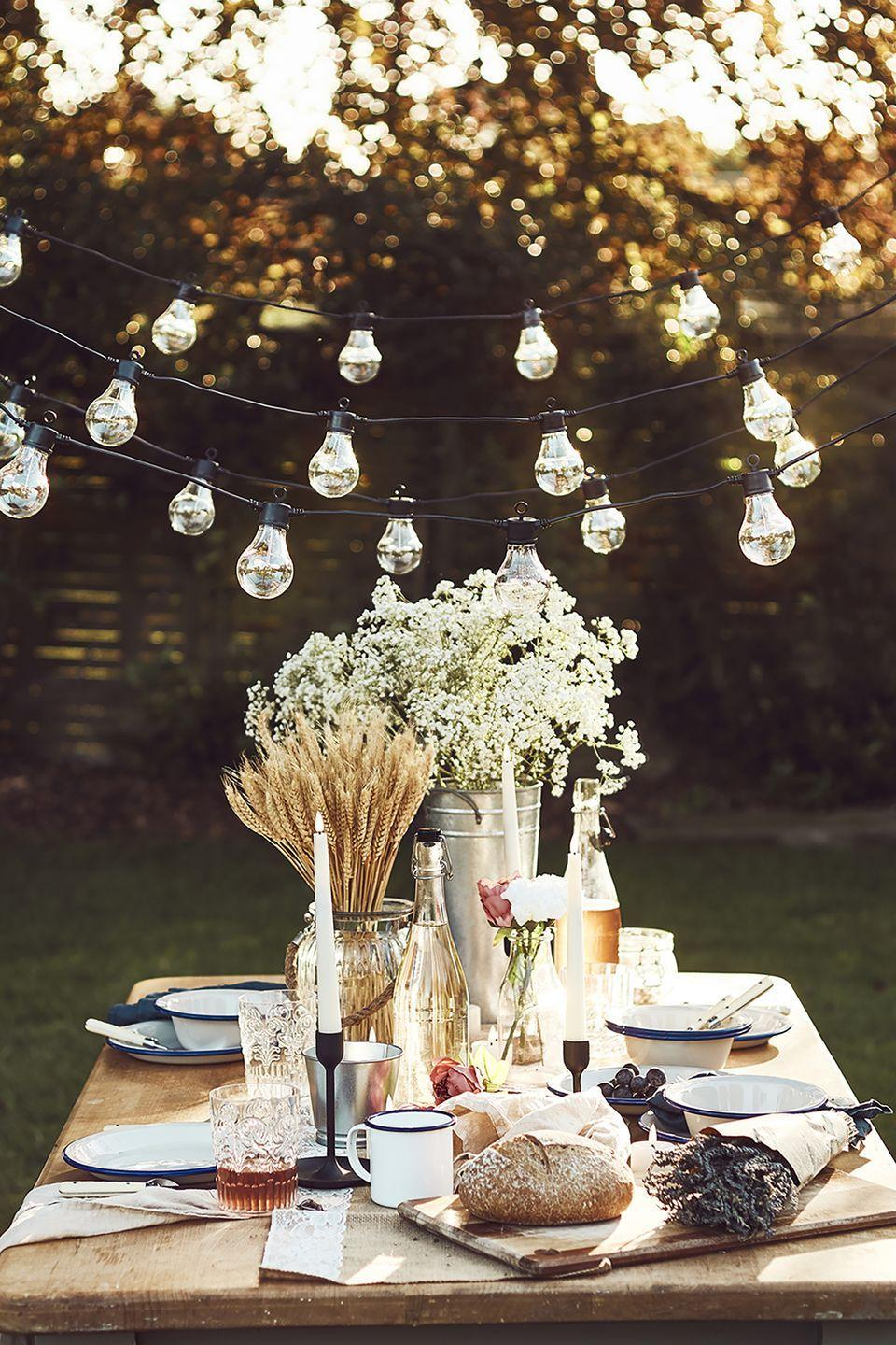 """<p>Hosting a group of six? To create a truly Insta-ready space, consider sprucing up your humble outdoor table with matching napkins, bouquets of fresh blooms, candles, gorgeous dinnerware sets, and plenty of festoon lights, too. </p><p><a href=""""https://go.redirectingat.com?id=127X1599956&url=https%3A%2F%2Fwww.lights4fun.co.uk%2F&sref=https%3A%2F%2Fwww.housebeautiful.com%2Fuk%2Fgarden%2Fg36276312%2Finstagrammable-garden%2F"""" rel=""""nofollow noopener"""" target=""""_blank"""" data-ylk=""""slk:Shop the full look at Lights4Fun"""" class=""""link rapid-noclick-resp"""">Shop the full look at Lights4Fun</a></p>"""