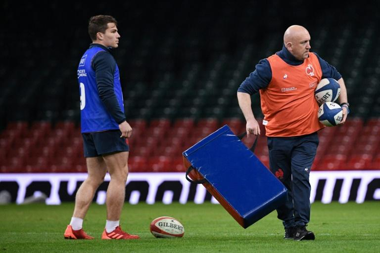France's defence coach Shaun Edwards was on familiar ground during the captain's run but for young scrum half Antoine Dupont it will be his first international at the Principality stadium in Cardiff (AFP Photo/Anne-Christine POUJOULAT)