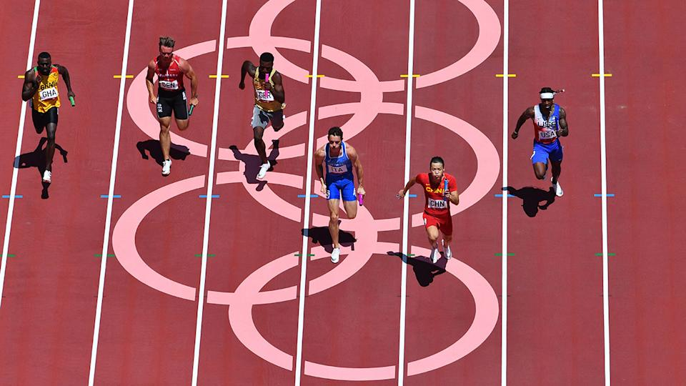 China, pictured here winning their 4x100m relay heat as USA missed the final.