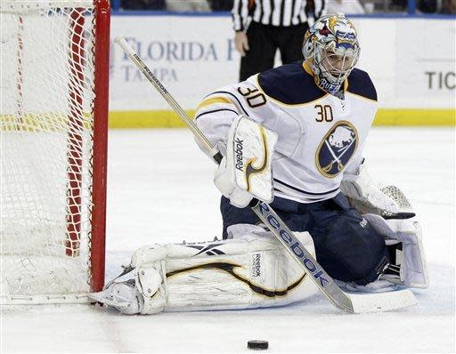 Buffalo Sabres goalie Ryan Miller (30) makes a save on a shot by the Tampa Bay Lightning during the second period of an NHL hockey game, Monday, March 19, 2012, in Tampa, Fla. (AP Photo/Chris O'Meara)