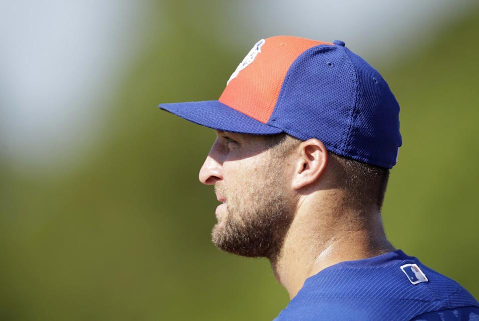 <p>Tim Tebow watches during a practice before his first instructional league baseball game for the New York Mets against the St. Louis Cardinals instructional club Wednesday, Sept. 28, 2016, in Port St. Lucie, Fla. (AP Photo/Luis M. Alvarez) </p>
