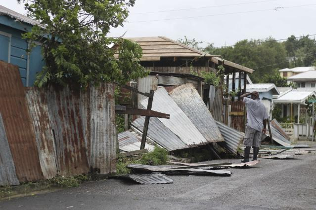 <p>A man surveys the wreckage on his property after the passing of Hurricane Irma, in St. John's, Antigua and Barbuda, Wednesday, Sept. 6, 2017. (Photo: Johnny Jno-Baptiste/AP) </p>