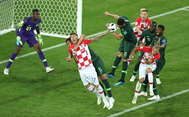 Soccer Football - World Cup - Group D - Croatia vs Nigeria - Kaliningrad Stadium, Kaliningrad, Russia - June 16, 2018 Nigeria's William Troost-Ekong fouls Croatia's Mario Mandzukic in the penalty area REUTERS/Lucy Nicholson TPX IMAGES OF THE DAY
