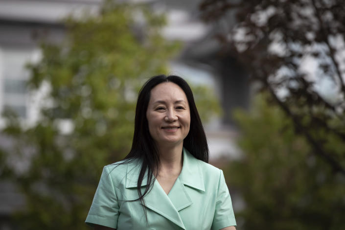 Meng Wanzhou, chief financial officer of Huawei, smiles as she leaves home to attend her extradition hearing at B.C. Supreme Court, in Vancouver, British Columbia, Monday, Aug. 9, 2021. (Darryl Dyck/The Canadian Press via AP)