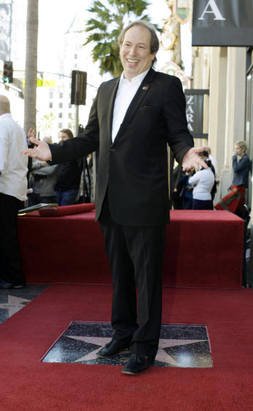 FILE - Composer Hans Zimmer poses during dedication ceremonies for his new star on the Hollywood Walk of Fame in Los Angeles in this Dec. 8, 2010 file photo. The Academy Awards producers said Thursday Dec. 8, 2011 that Hans Zimmer and Pharrell Williams will serve as the show's music consultants. Neither musician has worked on the Oscars before. (AP Photo/Reed Saxon, File)