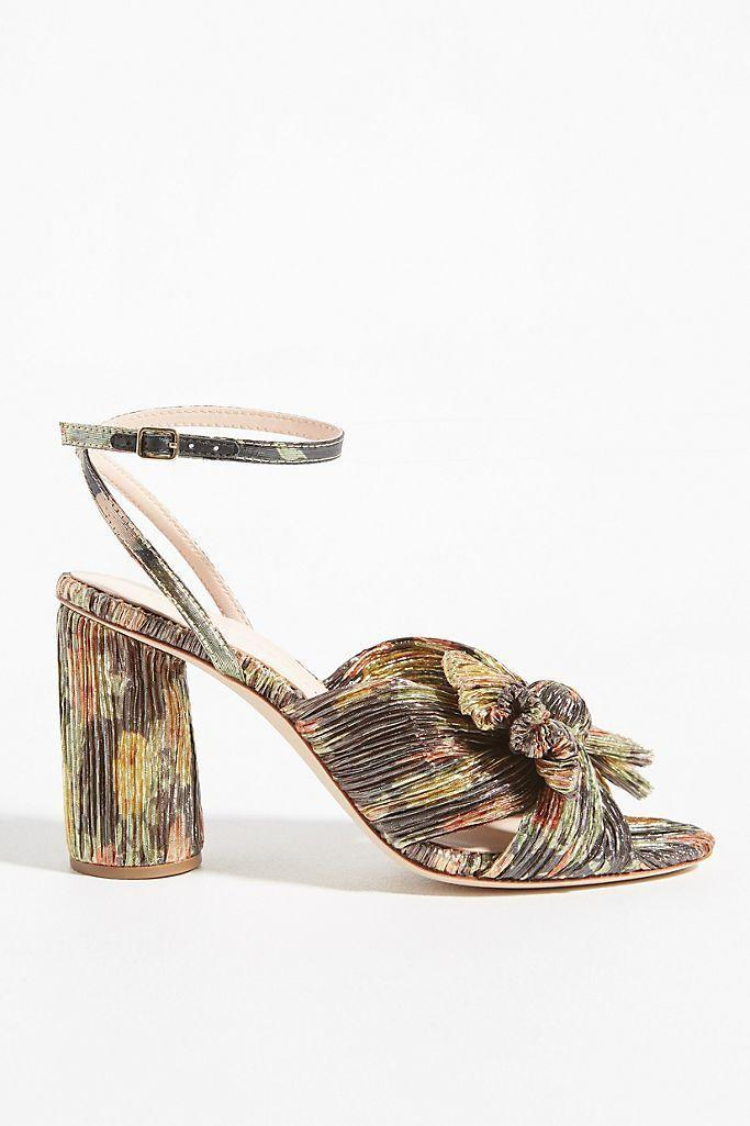 "<p><strong>Loeffler Randall Anthropologie</strong></p><p>anthropologie.com</p><p><strong>$395.00</strong></p><p><a href=""https://go.redirectingat.com?id=74968X1596630&url=https%3A%2F%2Fwww.anthropologie.com%2Fshop%2Floeffler-randall-camellia-heels8&sref=https%3A%2F%2Fwww.veranda.com%2Fshopping%2Fg34313364%2Fgrandmillennial-gift-guide%2F"" rel=""nofollow noopener"" target=""_blank"" data-ylk=""slk:Shop Now"" class=""link rapid-noclick-resp"">Shop Now</a></p>"