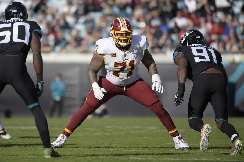 Washington left tackle Trent Williams, shown here last December, could not comfortably wear a helmet during his team physical. (AP/Phelan M. Ebenhack)
