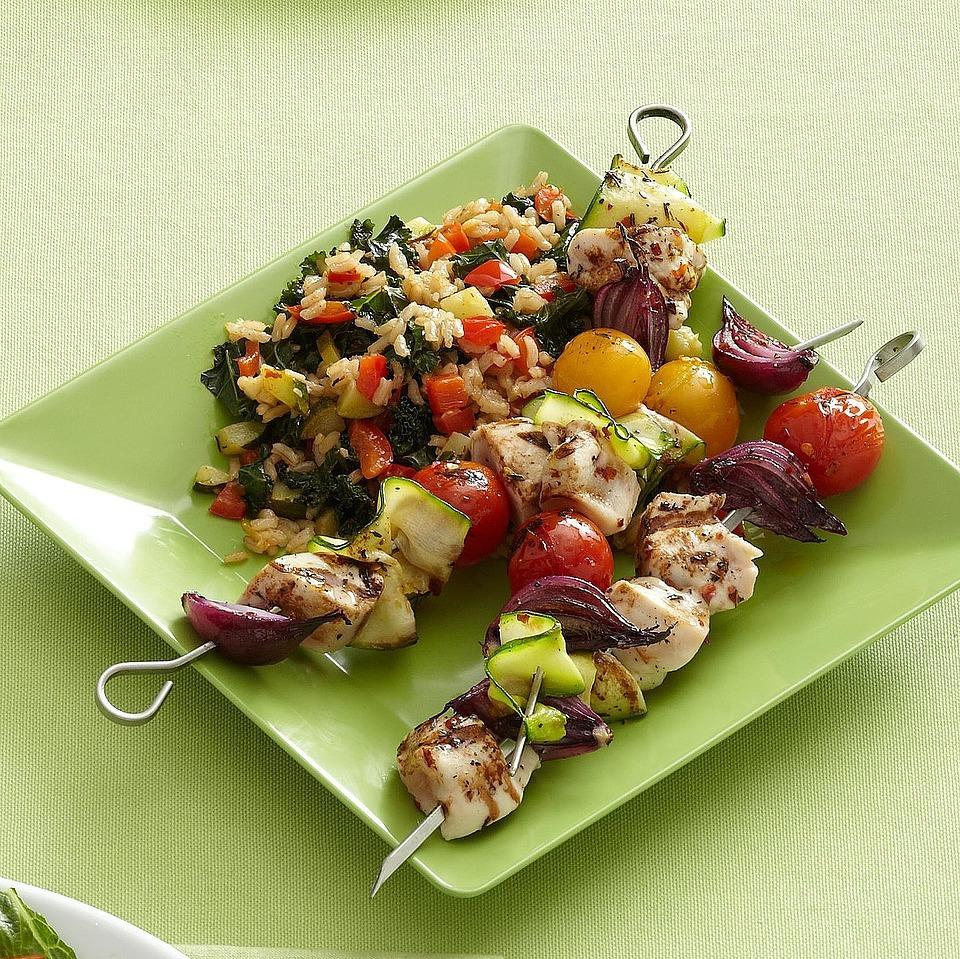 """<p>Because it's ready in under an hour, this chicken and rice dish is ideal for any weeknight meal. <a href=""""http://www.eatingwell.com/recipe/265630/spicy-chicken-kabobs-with-vegetable-rice/"""" rel=""""nofollow noopener"""" target=""""_blank"""" data-ylk=""""slk:View recipe"""" class=""""link rapid-noclick-resp""""> View recipe </a></p>"""