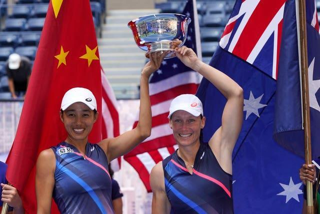 Zhang Shuai and Sam Stosur lift the women's doubles trophy