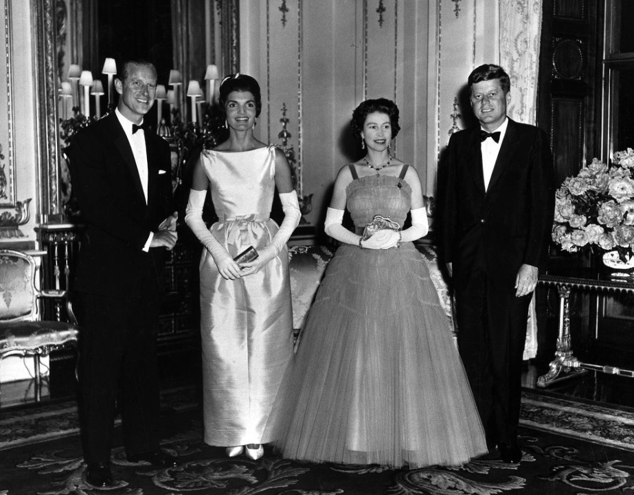 In this picture from 1961, Queen Elizabeth and Prince Philip host a Queen's Dinner for President John F Kennedy and Jackie Kennedy at Buckingham Palace. (Wikipedia)
