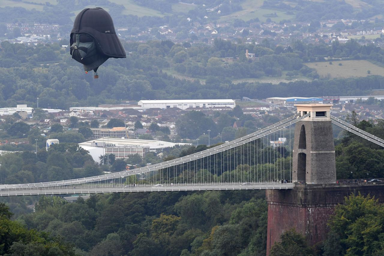 The Darth Vader balloon flies above the Clifton Suspension Bridge (Finnbarr Webster/Getty Images)