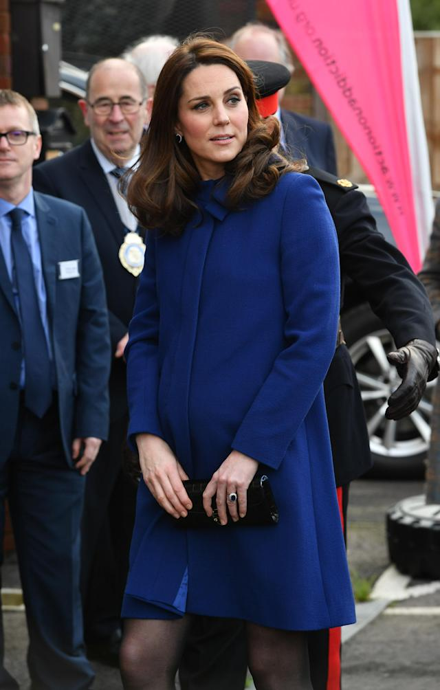 An etiquette expert reveals the meaning behind the Duchess of Cambridge's body language. (Photo: Getty Images)