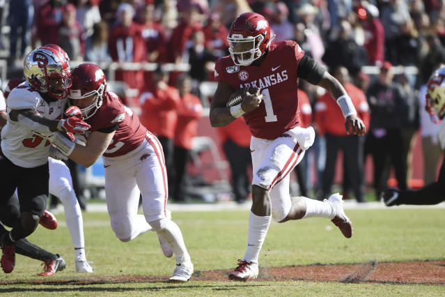 Arkansas quarterback K.J. Jefferson runs the ball against Western Kentucky during the second half of an NCAA college football game, Saturday, Nov. 9, 2019 in Fayetteville, Ark. (AP Photo/Michael Woods)