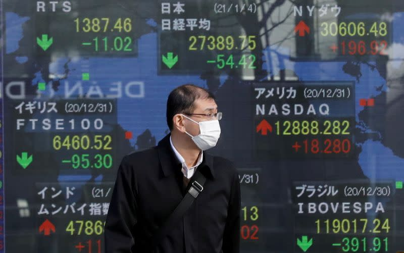FILE PHOTO: First trading day of stock market in Tokyo