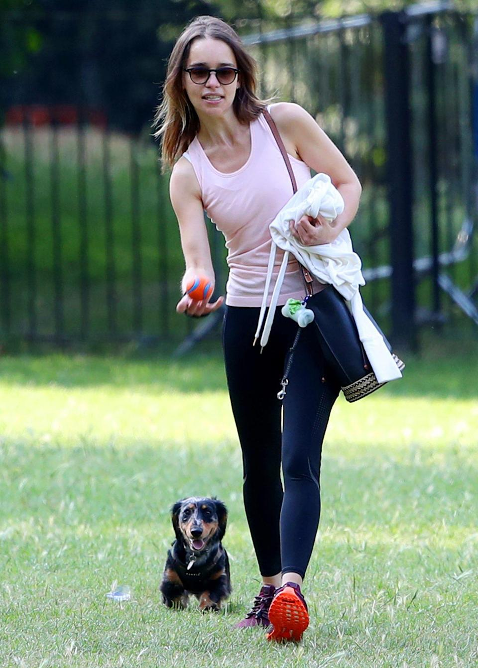 <p>Emilia Clarke plays fetch with her dog on Wednesday in London. </p>