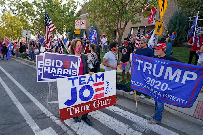 People proclaim their support near the site of the vice presidential debate Oct. 7 in Salt Lake City.