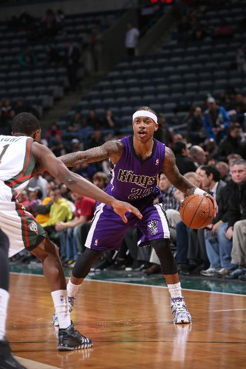 MILWAUKEE, WI - MARCH 5: Isaiah Thomas #22 of the Sacramento Kings handles the ball against the Milwaukee Bucks on March 5, 2014 at the BMO Harris Bradley Center in Milwaukee, Wisconsin. (Photo by Gary Dineen/NBAE via Getty Images)