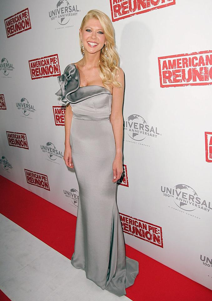 "Tara Reid -- whose had her fair share of fashion flubs over the years -- made a triumphant return to the red carpet on Wednesday evening at the Australian premiere of <a target=""_blank"" href=""http://yhoo.it/xc8blf"">""American Pie: Reunion.""</a> The 36-year-old actress -- who rose to fame over 10 years ago thanks to the successes of ""The Big Lebowski,"" ""Urban Legend,"" and the original ""American Pie"" -- was all smiles in a sophisticated column gown and sideswept tresses. (3/7/2012)"