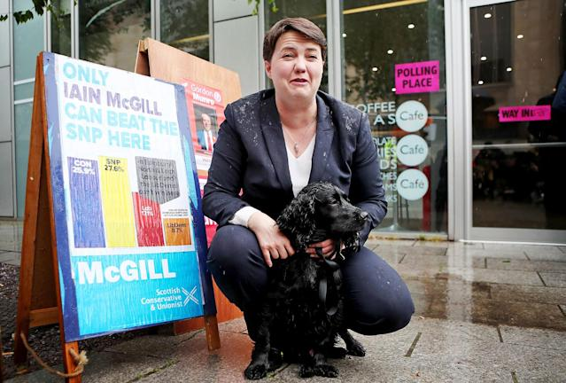 <p>Scottish Conservative leader Ruth Davidson with her dog, called Wilson, as she arrives to cast her vote in the General Election at a polling station at Cafe Comino in Edinburgh. (Photo: Jane Barlow//Getty Images) </p>