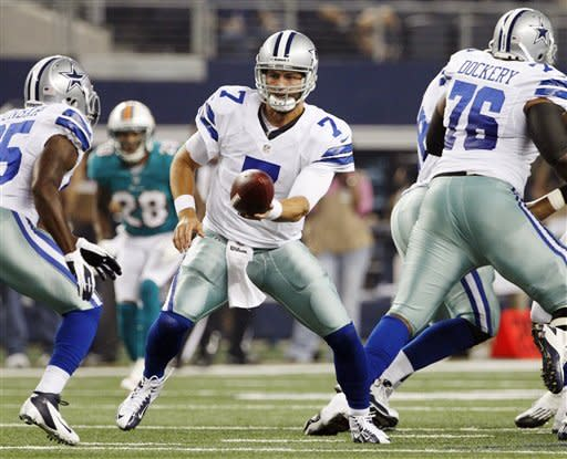 Dallas Cowboys quarterback Stephen McGee (7) hands the ball to Lance Dunbar (25) during the first half of a preseason NFL football game against the Miami Dolphins, Wednesday, Aug. 29, 2012, in Arlington, Texas. (AP Photo/Tony Gutierrez)