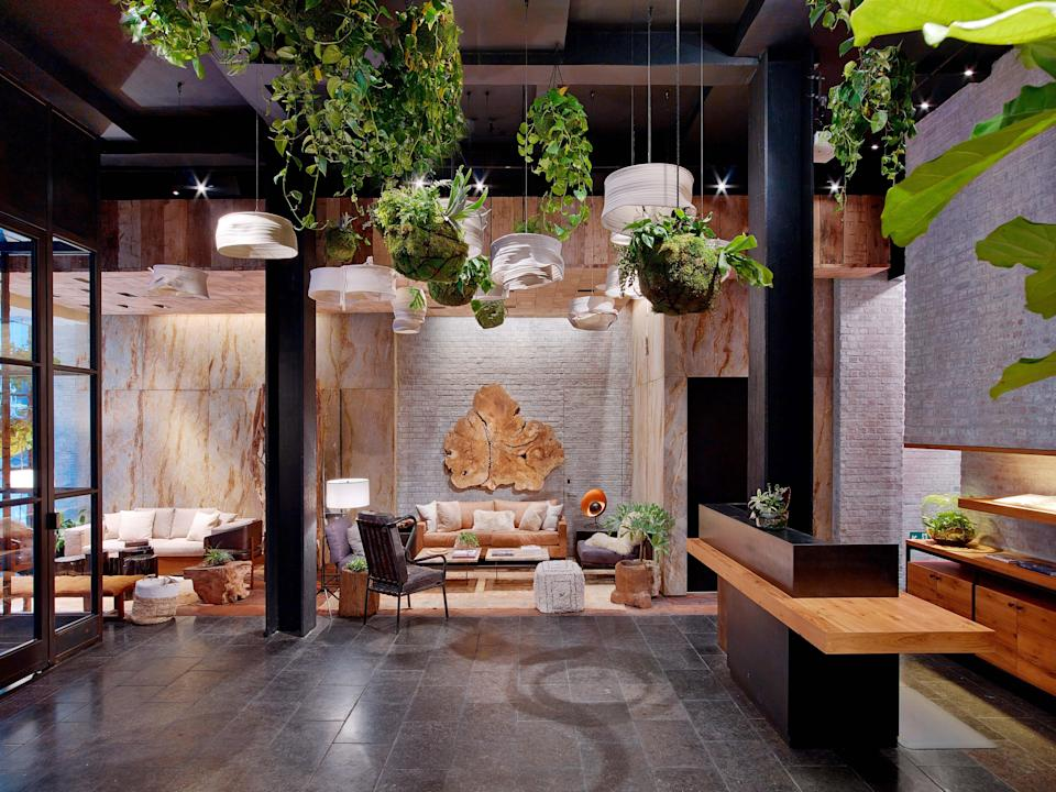 This 229-room, eco-conscious hotel is designed by AvroKo group and Kemper Hyers. Rooms come with stylish reclaimed wood furniture, recycled cardboard hangers in the closet, hemp Keetsa mattresses topped with organic cotton sheets, and a Google Nexus tablet that tracks your carbon footprint. The clever details don't end there, either: The floor in the fitness center is actually the old University of Wisconsin basketball court; restrooms feature moss growing on the ceilings; and even the hotel's three-story living-wall exterior is composed of recycled materials and helps to conserve water.