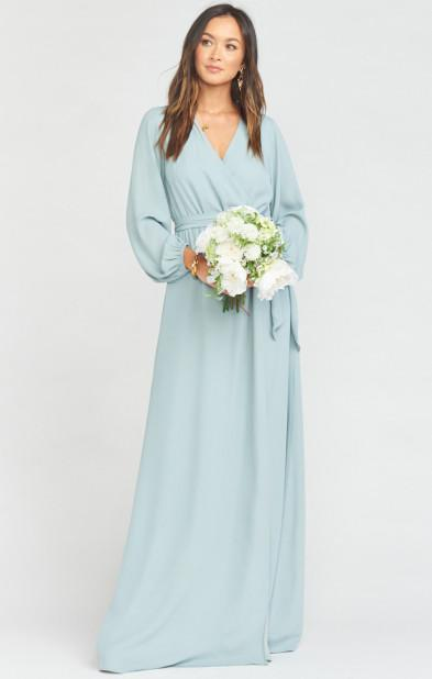 """<h3>Show Me Your Mumu</h3><br><strong>Price Range: </strong>$98 - $286<br><strong>Size Range: </strong>XXS - 3X<br><br>The, um, <em>creatively</em> named dress destination stock almost every conceivable bridesmaid-dress silhouette in over 35 colors, which are grouped by family (neutrals, jewel tones, metallics, etc) for easy shopping. Expecting 'maids can shop their """"muternity"""" section for baby-belly friendly silhouettes, and the <a href=""""https://www.showmeyourmumu.com/shop/mumu-wedding/bridesmaids/plus-size-bridesmaids"""" rel=""""nofollow noopener"""" target=""""_blank"""" data-ylk=""""slk:extended sizes section"""" class=""""link rapid-noclick-resp"""">extended sizes section</a> isolates the dresses available in sizes 1X - 3X. If you need an IRL fitting-room experience, you can try on styles at select <a href=""""https://www.showmeyourmumu.com/nordstom-retail-locations"""" rel=""""nofollow noopener"""" target=""""_blank"""" data-ylk=""""slk:Nordstrom Wedding Suite and Bridal Bar locations"""" class=""""link rapid-noclick-resp"""">Nordstrom Wedding Suite and Bridal Bar locations</a> all over the country.<br><br><em>Shop <strong><a href=""""https://www.showmeyourmumu.com/shop/mumu-wedding/bridesmaids"""" rel=""""nofollow noopener"""" target=""""_blank"""" data-ylk=""""slk:Show Me Your Mumu"""" class=""""link rapid-noclick-resp"""">Show Me Your Mumu</a></strong></em><br><br><strong>Show Me Your Mumu</strong> Lady Long Sleeve Wrap Dress, $, available at <a href=""""https://go.skimresources.com/?id=30283X879131&url=https%3A%2F%2Fwww.showmeyourmumu.com%2Fshop%2Fmumu-wedding%2Fbridesmaids%2Flady-long-sleeve-wrap-dress-silver-sage-crisp"""" rel=""""nofollow noopener"""" target=""""_blank"""" data-ylk=""""slk:Show Me Your Mumu"""" class=""""link rapid-noclick-resp"""">Show Me Your Mumu</a>"""