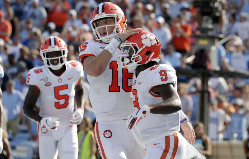 Clemson's Travis Etienne (9) celebrates his touchdown with Trevor Lawrence (16) and Tee Higgins (5) during the second quarter of an NCAA college football game against North Carolina in Chapel Hill, N.C., Saturday, Sept. 28, 2019. (AP Photo/Chris Seward)