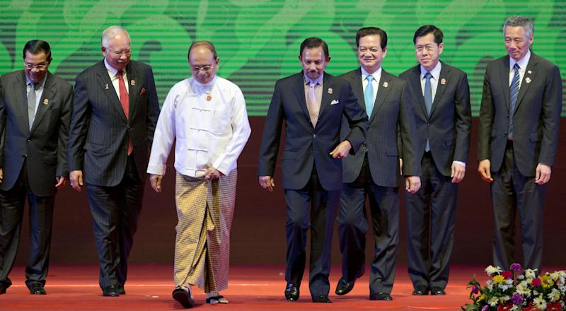 CORRECTS THE ID OF VIETNAMESE LEADER - Leaders of the Association of Southeast Asian Nations walk after posing for a photograph during the 24th ASEAN leaders Summit in Naypyitaw, Myanmar, Sunday, May 11 2014. Leaders from left, Cambodian Prime Minister Hun Sen, Malaysian Prime Minister Najib Razak, Myanmar President Thein Sein, Sultan of Brunei Hassanal Bolkiah, Vietnamese Prime Minister Nguyen Tan Dung, Thailand caretaker Deputy Prime Minister Phongthep Thepkanjana, Singaporean Prime Minister Lee Hsien Loong. (AP Photo/Gemunu Amarasinghe)