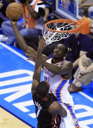 Oklahoma City Thunder power forward Serge Ibaka (9) from Republic of Congo shoots against Miami Heat power forward Chris Bosh during the first half at Game 2 of the NBA finals basketball series, Thursday, June 14, 2012, in Oklahoma City. (AP Photo/Sue Ogrocki)