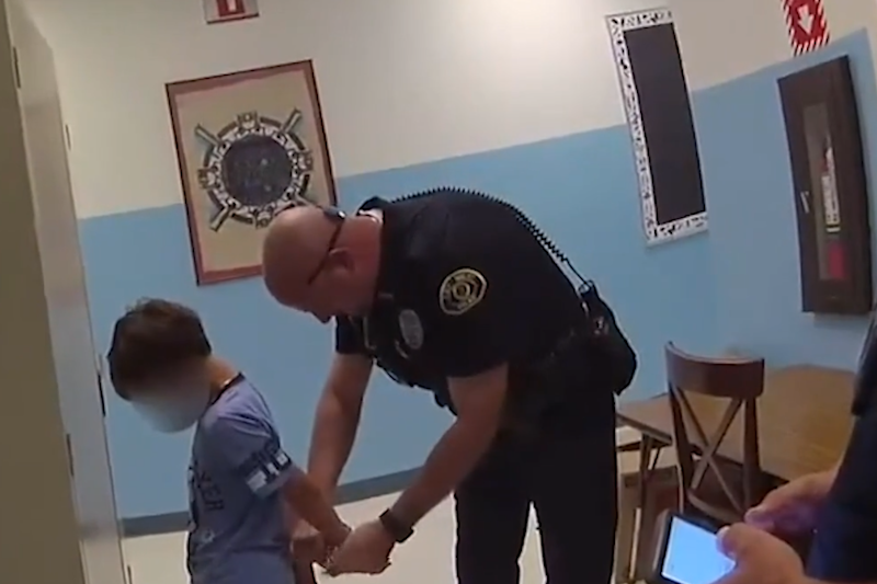 Bodycam footage shows the moment police placed the eight-year-old boy in handcuffs (Florida police)