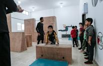A coach trains Palestinian children at the Wallrunners Parkour Academy in Gaza; parkour is an extreme sport also known as free-running that originated in France in the 1990s