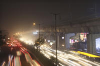 Cars drive on a road engulfed in smog in New Delhi, India, Thursday, Nov. 5, 2020. A thick quilt of smog lingered over the Indian capital and its suburbs on Friday, fed by smoke from raging agricultural fires that health experts worry could worsen the city's fight against the coronavirus. Air pollution in parts of New Delhi have climbed to levels around nine times what the World Health Organization considers safe, turning grey winter skies into a putrid yellow and shrouding national monuments. (AP Photo/Manish Swarup)