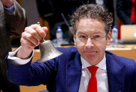 FILE PHOTO: Dutch Finance Minister and Eurogroup President Jeroen Dijsselbloem rings the bell as he chairs a Eurozone finance ministers meeting in Brussels, December 4, 2017. REUTERS/Francois Lenoir/File Photo