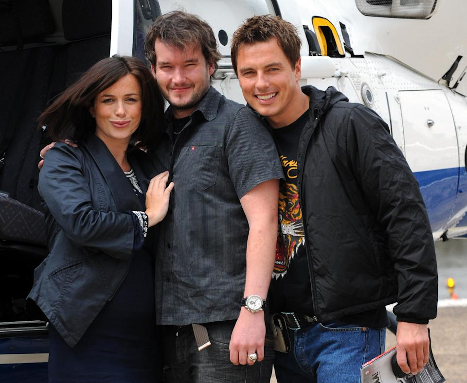 The cast of Torchwood 'Children of Earth', (left to right) Eve Myles, Gareth David-Lloyd and John Barrowman, depart London for Cardiff at London Heliport after the London launch of the DVD and Blu-Ray release of the BBC1 drama.   (Photo by Fiona Hanson/PA Images via Getty Images)