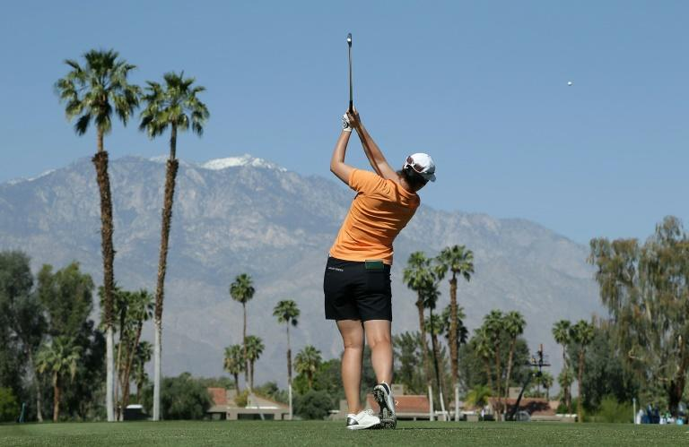 Caroline Masson of Germany plays a tee shot on the fifth hole during the completion of the first round of the ANA Inspiration at the Dinah Shore Tournament Course at Mission Hills Country Club on March 30, 2017 in Rancho Mirage, California