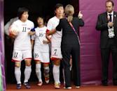 A major diplomatic incident marred the first day of competition at the London Olympics when the North Korea women's football team walked off after the South Korea flag was mistakenly displayed before their match against Colombia. North Korea's captain Kim Chung-Sim, Kim Song-Hui and Ri Ye-Gyong (L-3rd L) walk out into the arena ahead of their women's Group G football match against Colombia at the London 2012 Olympic Games in Hampden Park, Glasgow, Scotland July 25, 2012.