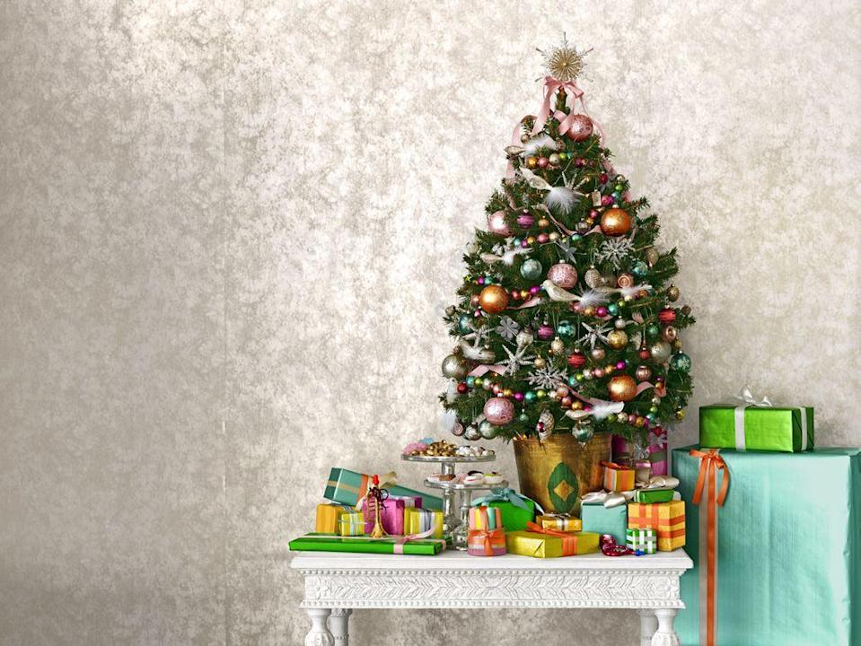 """<p>When tucked deeper toward the middle of the tree, ribbon garland helps fill in holes and adds some unifying color to your Christmas tree, while letting your ornaments and other decorative garlands take center stage. To get the look, add the ribbon garlands prior to hanging your other ornaments, making sure to tuck the ribbon further back into the branches.</p><p><a class=""""link rapid-noclick-resp"""" href=""""https://www.amazon.com/Berwick-Offray-Double-Satin-Ribbon/dp/B00FN38N8U?tag=syn-yahoo-20&ascsubtag=%5Bartid%7C10050.g.28703522%5Bsrc%7Cyahoo-us"""" rel=""""nofollow noopener"""" target=""""_blank"""" data-ylk=""""slk:SHOP RIBBON"""">SHOP RIBBON</a></p>"""