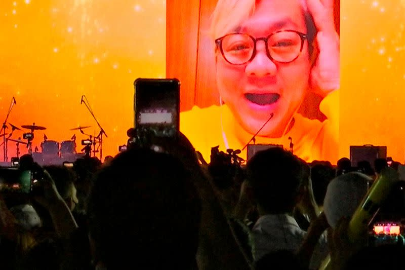 A still image from a video shows image of a former diplomat Pavin Chachavalpongpun projected at a demonstration in Bangkok