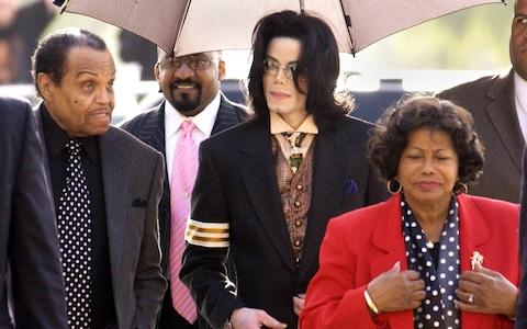 Michael Jackson with his father Joe and mother Katherine at court in 2005 for the singer's child molestation trial - Credit: Getty Images North America