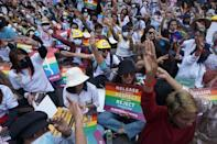 Members of the Myanmar LGBT community display the three finger salute -- a symbol of resistance borrowed from the Hunger Games film trilogy
