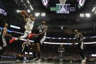 Milwaukee Bucks' Giannis Antetokounmpo drives during the first half of an NBA basketball game against the San Antonio Spurs Saturday, Jan. 4, 2020, in Milwaukee. (AP Photo/Morry Gash)