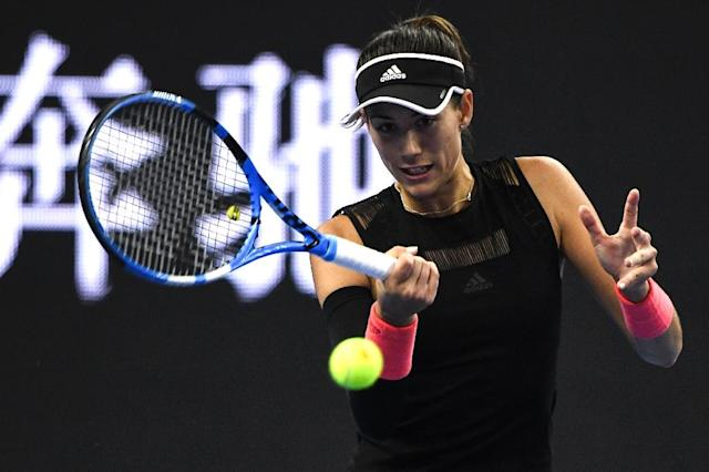 Spanish former Wimbledon and French Open champion Garbine Muguruza brushed aside Ana Bogdan with the loss of only three games to underline her status as one of the tournament favourites (AFP Photo/FRED DUFOUR)