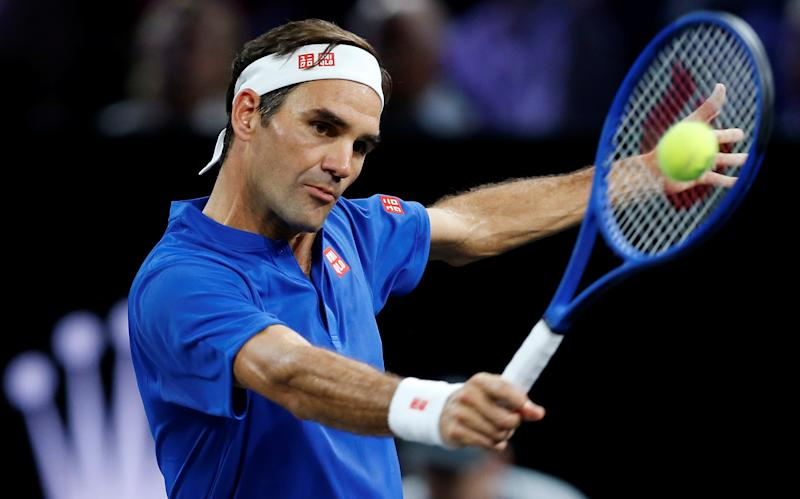 Tennis - Laver Cup - Palexpo, Geneva, Switzerland - September 22, 2019 Team Europe's Roger Federer in action during his singles match against Team World's John Isner REUTERS/Pierre Albouy