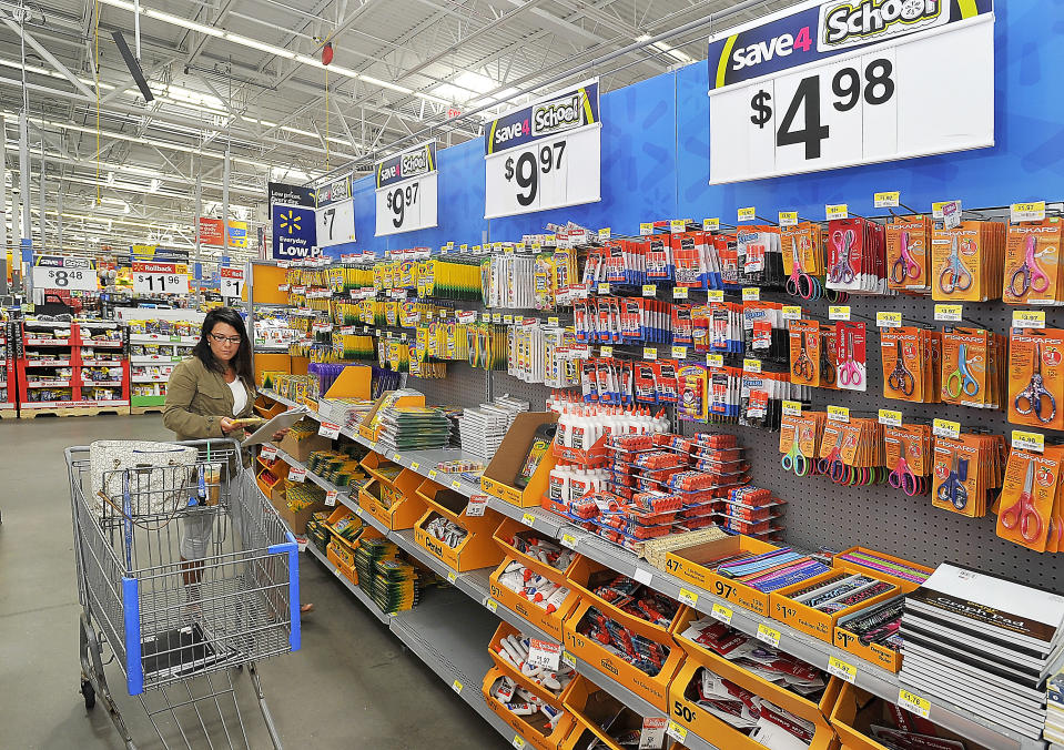 SCARBOROUGH, ME - AUGUST 20: Sarah Patten of Portland, a student at USM, shops for back to school items for herself and a seven-year-old she nannies for at Walmart in Scarborough. (Photo by Gordon Chibroski/Portland Press Herald via Getty Images)
