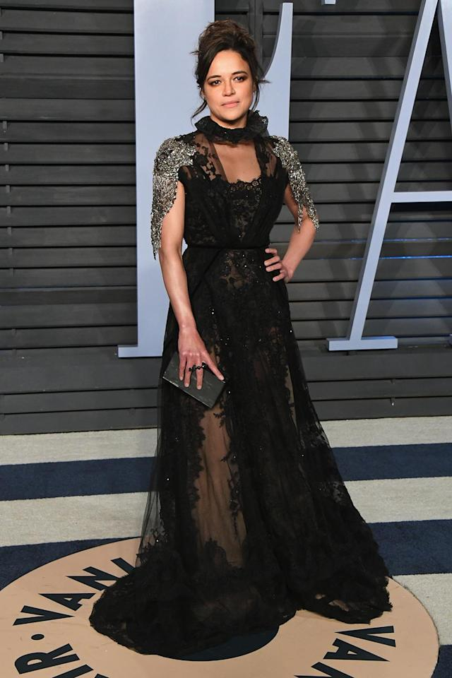 <p>The actress hit up <em>Vanity Fair</em>'s after-party in a darkly romantic black gown with a ruffled neck. (Photo: Jon Kopaloff/WireImage) </p>